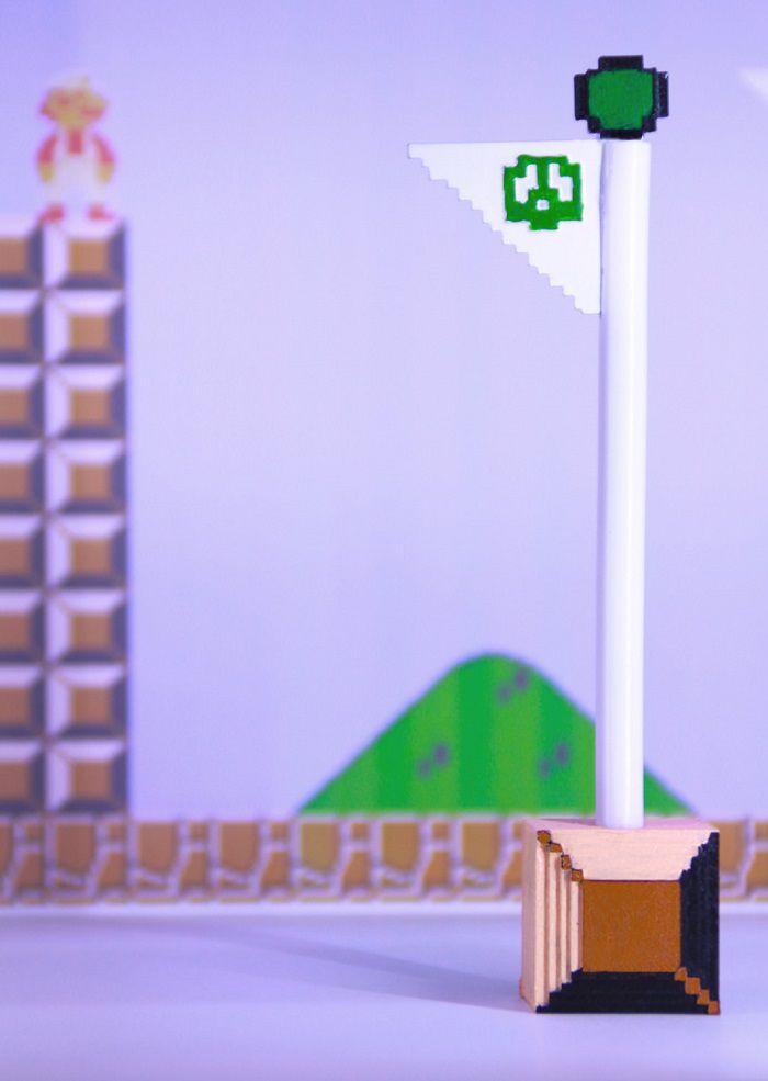 mario-stylo-flagpole-drapeau-niveau-super-bros-8-bit [700 x 985]